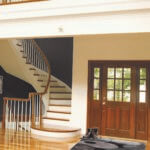Curved staircase using pin top wood balusters, style 5015, and both straight handrail and bending handrail in the Hard Maple wood species.